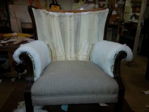 New padding installed on chair for re-upholstery