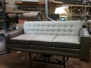 Sofa with a mix of leather and fabric.