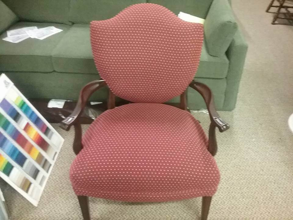 Re-upholstery of a wooden arm chair