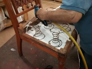 Straight back chair during reupholstery.